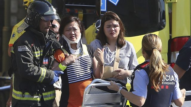 The injured are treated by medics at the scene of the terror attack in Barcelona