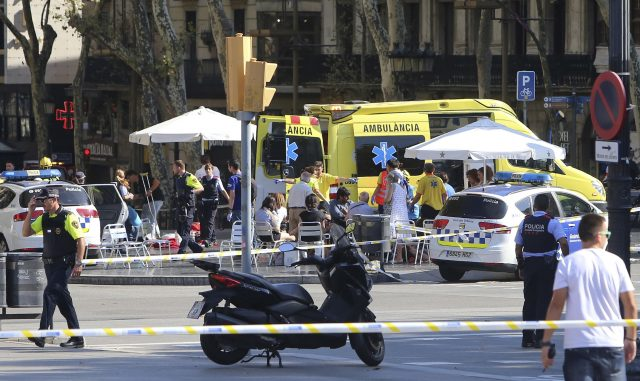 Injured people are treated in Barcelona after a terror attack