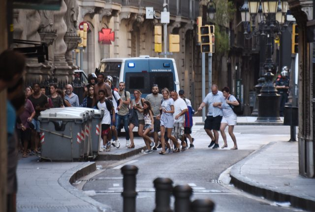 People flee from the scene of a terror attack in Barcelona