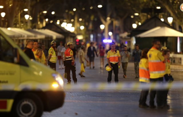 Emergency workers on a blocked street in Barcelona after a terror attack
