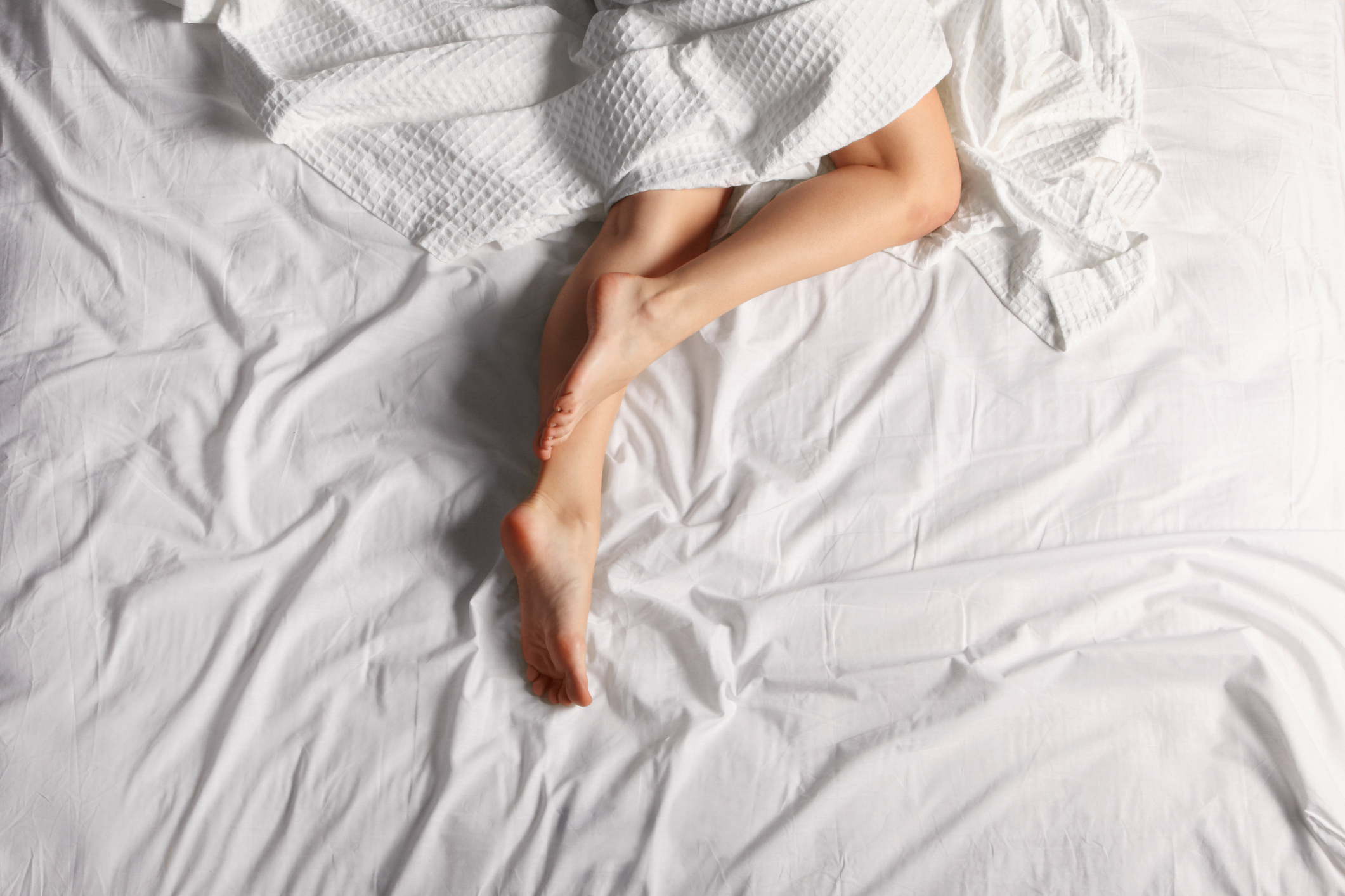 Woman's naked legs under a sheet (Thinkstock/PA)