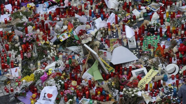 Flowers, messages and candles form a memorial tribute to the victims on Barcelona's historic Las Ramblas promenade