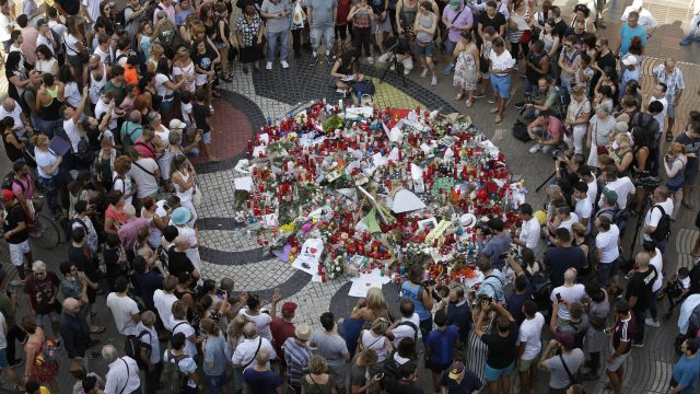 Tributes are laid at the scene of the van attack in Barcelona that killed 13 people