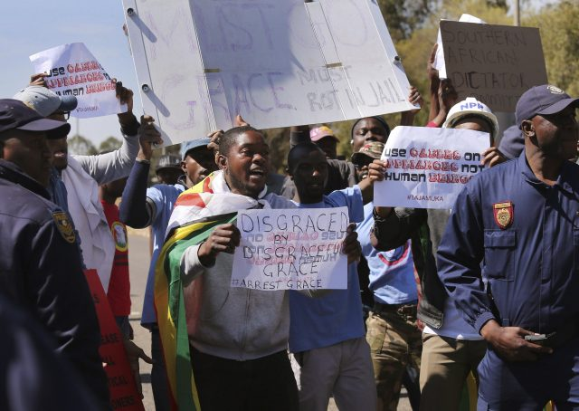 Anti-Mugabe demonstrators protest in Pretoria (AP)