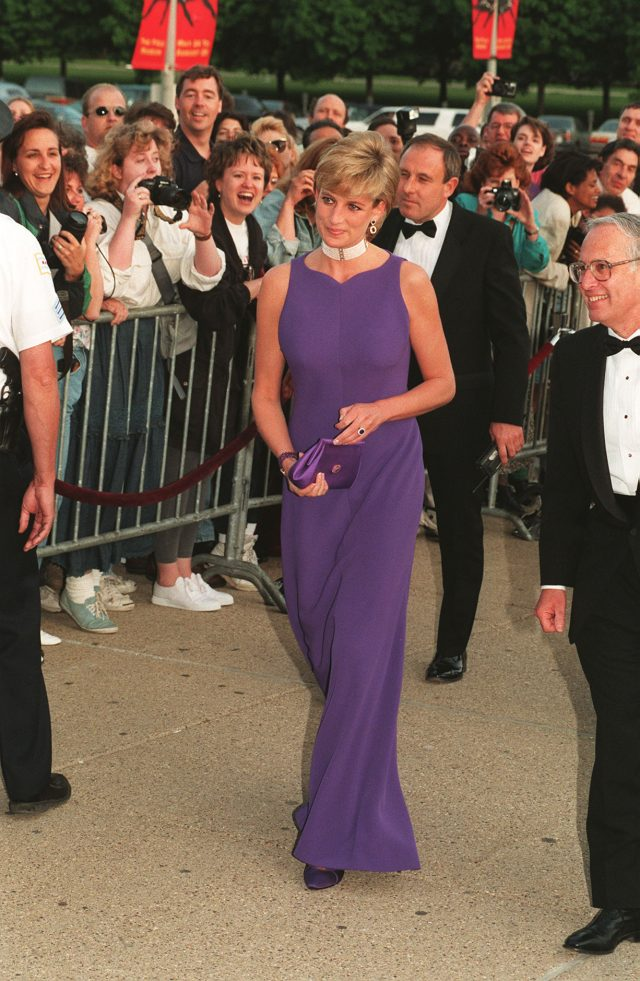 The Princess of Wales arrives at the Field Museum in Chicago, wearing a Versace dress