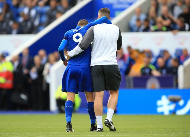 Jamie Vardy is helped from the field against Brighton