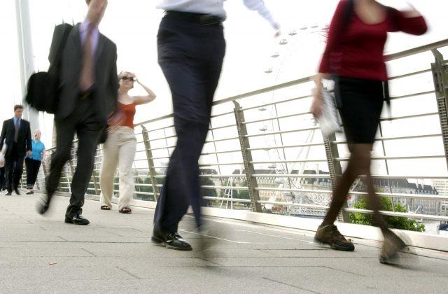 London commuters walk to work over the Millennium Bridge