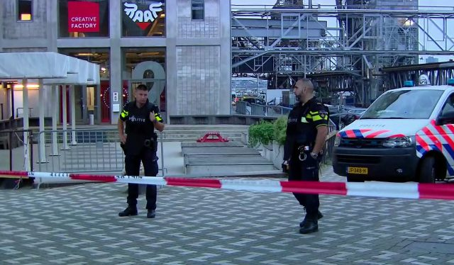 Officers stand behind a cordoned-off area in Rotterdam