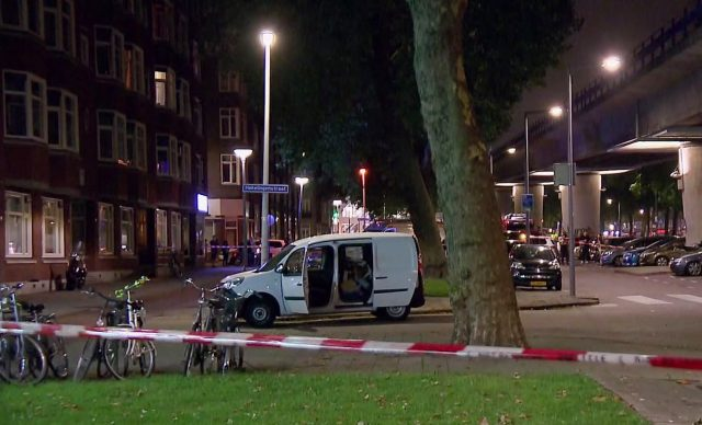 A van is examined behind a cordoned-off area in Rotterdam