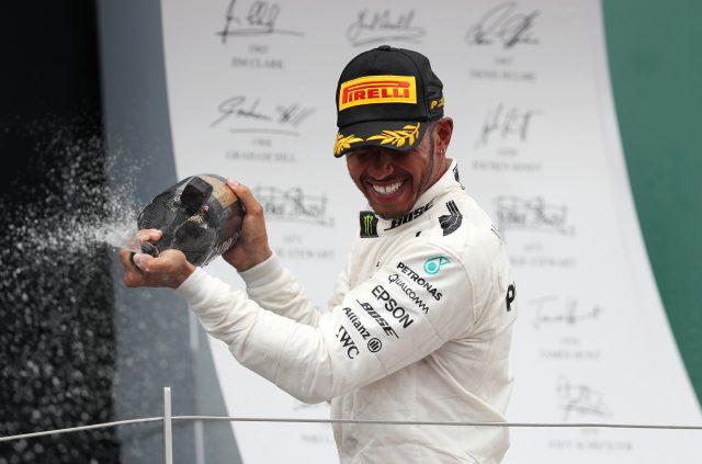 Lewis Hamilton celebrates victory after the 2017 British Grand Prix (David Davies/PA)