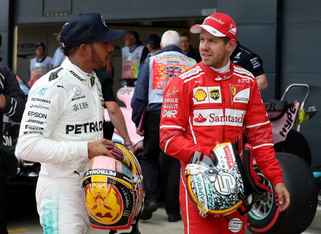 Mercedes' Lewis Hamilton (left) with Ferrari's Sebastian Vettel (right) after qualifying for the 2017 British Grand Prix at Silverstone Circuit, Towcester.