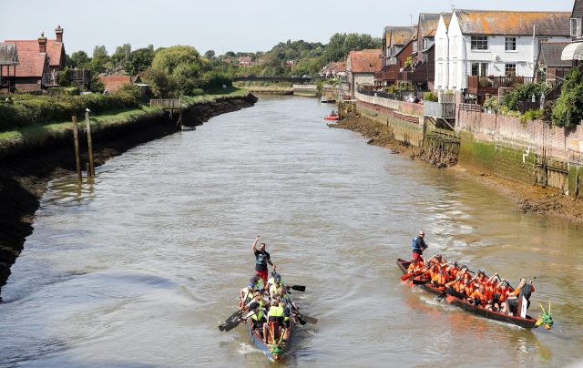 Dragon boaters on a river