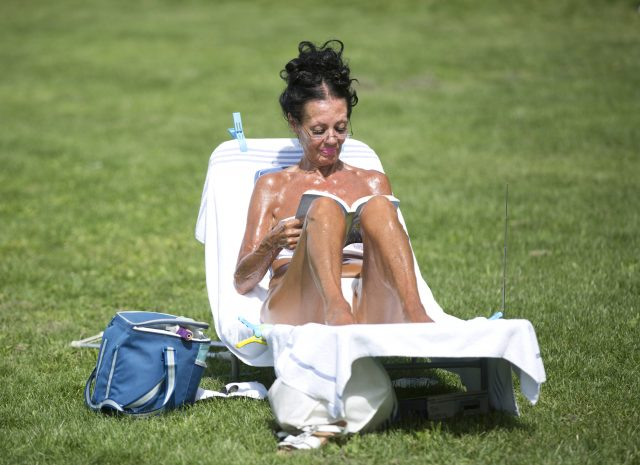 A woman sunbathes