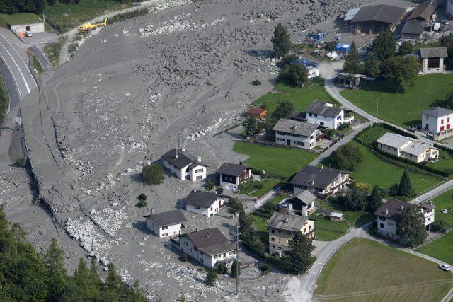 Eight still missing as Swiss villagers start to return home after mudslide