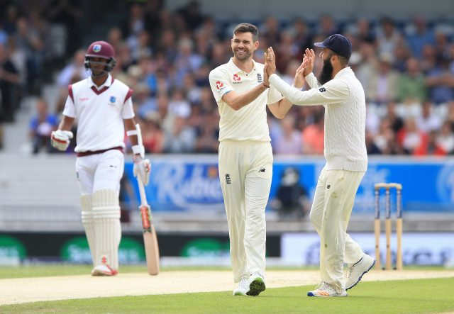 England's James Anderson (centre) celebrates with Moeen Ali after taking the wicket of West Indies Devendra Bishoo during day two of the the second Investec Test match at Headingley, Leeds.