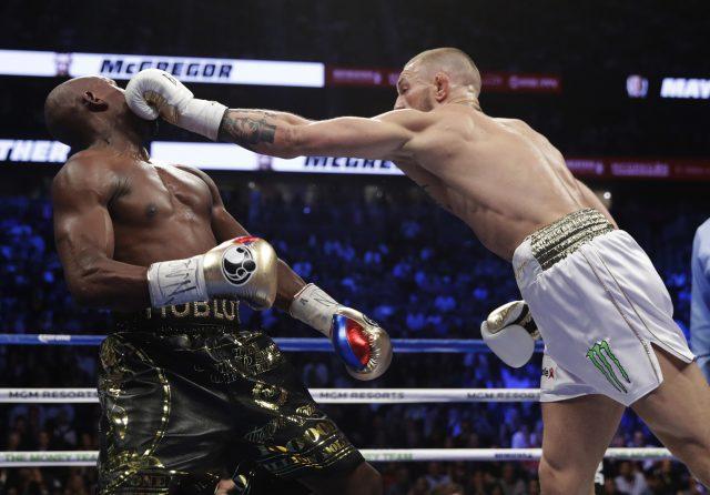 Conor McGregor hits Floyd Mayweather