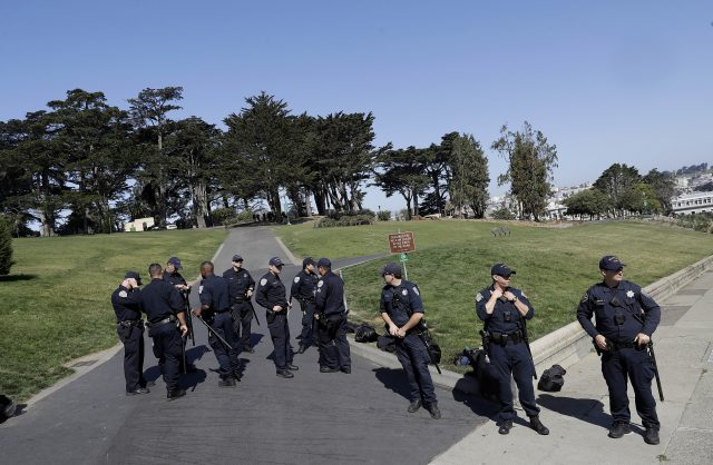 San Francisco Police Officers guard an entrance to Alamo Square Park in San Francisco