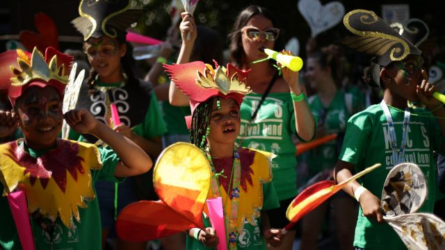 Dancers perform during the Family Day parade at the Notting Hill Carnival in west London