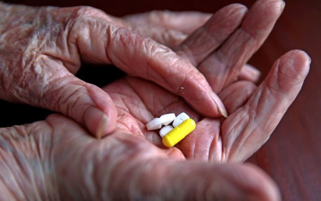 File photo dated 03/09/15 of a pensioner with her daily prescription drugs. Almost all men over 60 and women over 75 are eligible for statins, according to a new analysis.