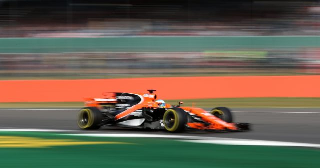 Fernando Alonso drives his McLaren at Silverstone