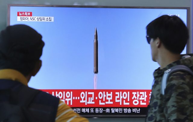 Kim Jong-un Hails Missile Launch as Trump Blusters