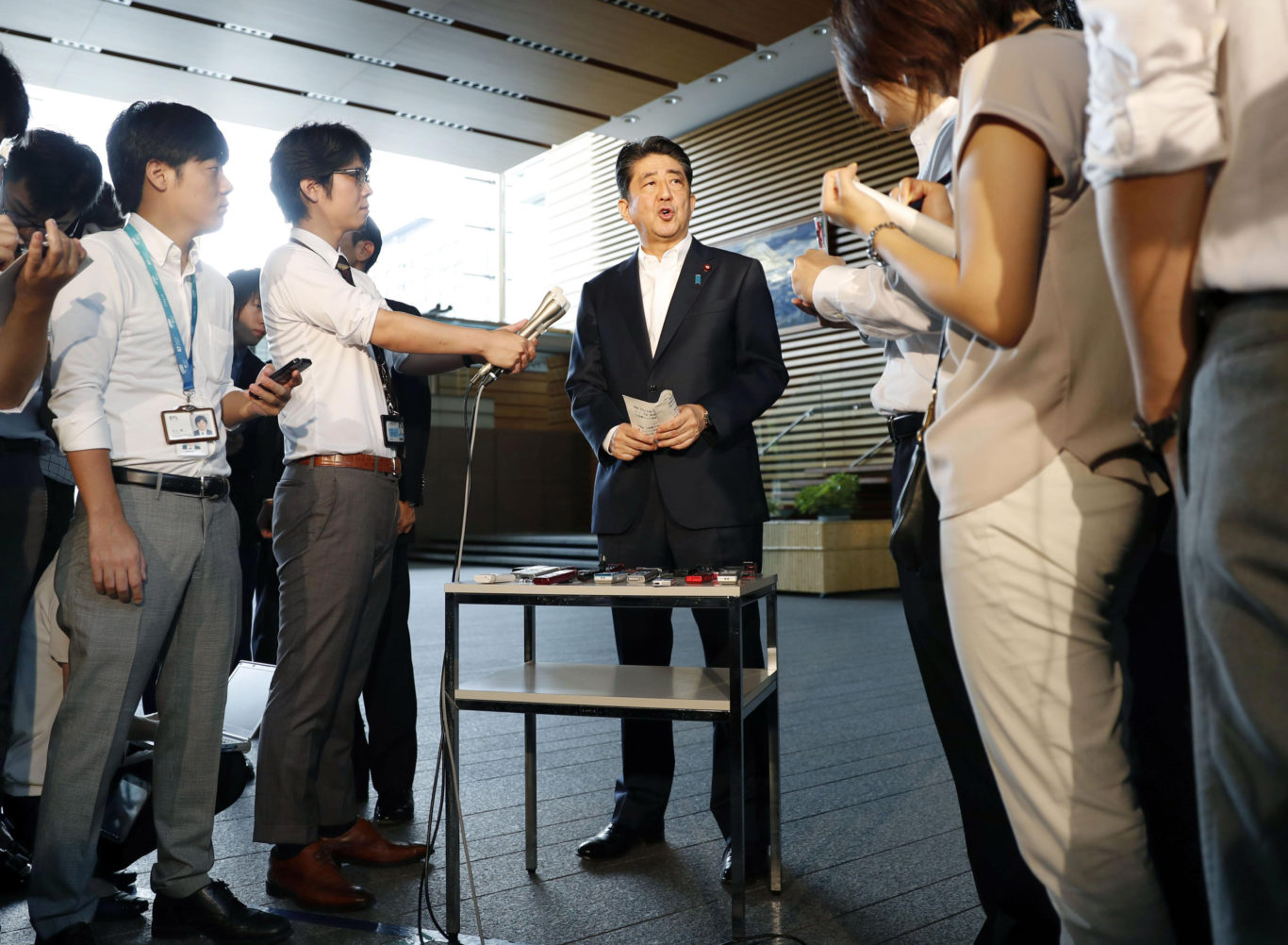 Shinzo Abe speaks to the press (AP)