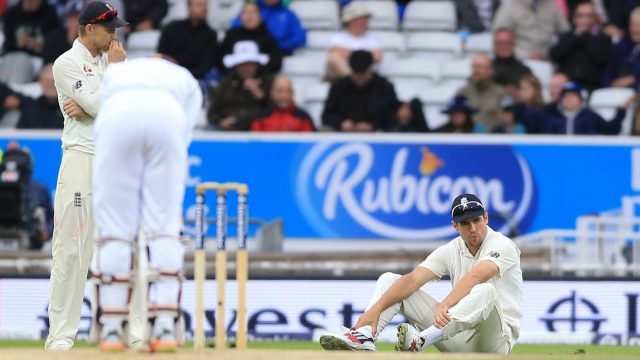 England's Alistair Cook (right) appears dejected after dropping a catch off West Indies Jermaine Blackwood