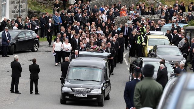 Mourners follow the funeral procession of Eilidh MacLeod after the service at Church of Our Lady, Star of the Sea, in Castlebay on the island of Barra