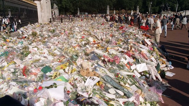 Floral tributes laid at the gates of Buckingham Palace following Princess Diana's death