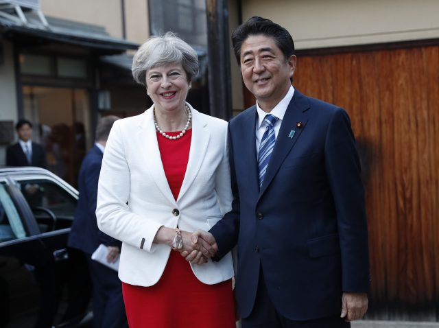 Theresa May is welcomed by Japan's Prime Minister Shinzo Abe