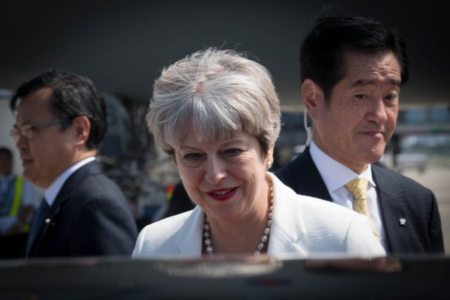 Britain's May says China should increase pressure on NKorea