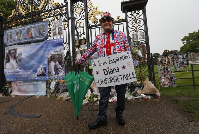 A Royal well-wisher stands at the gates of Kensington Palace