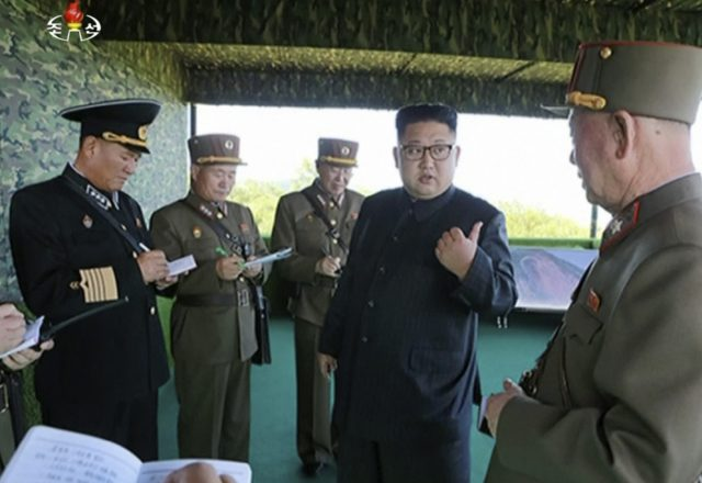 North Korean leader Kim Jong Un, second right, speaks with officials
