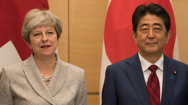 Prime Minister Theresa May and her Japanese counterpart Shinzo Abe meet with Japan's National Security Council at the Prime Minister's office in Tokyo where they discussed the situation with North Korea (Stefan Rousseau/PA)