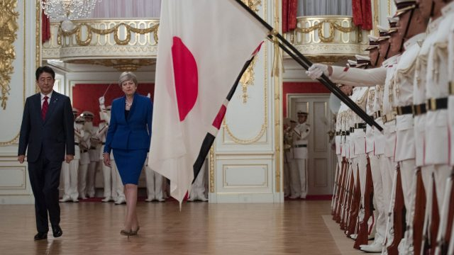 Japanese Prime Minister Shinzo Abe welcomes British Prime Minister Theresa May to the Akasaka Guest House in Tokyo (Stefan Rousseau/PA)