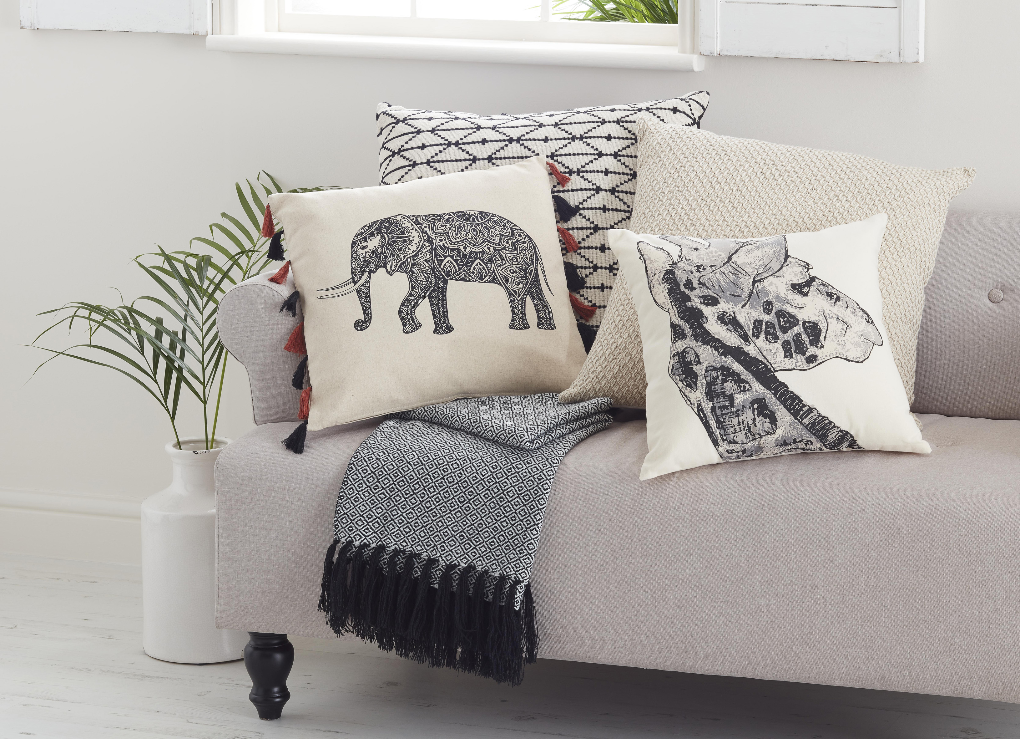 Orabelle Elephant Cushion, £8; Cintia Giraffe Cushion, £5, B&Q (B&Q/PA)