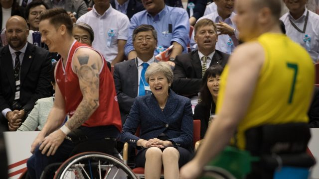Theresa May watches a game of wheelchair basketball between Great Britain and Australia in Tokyo