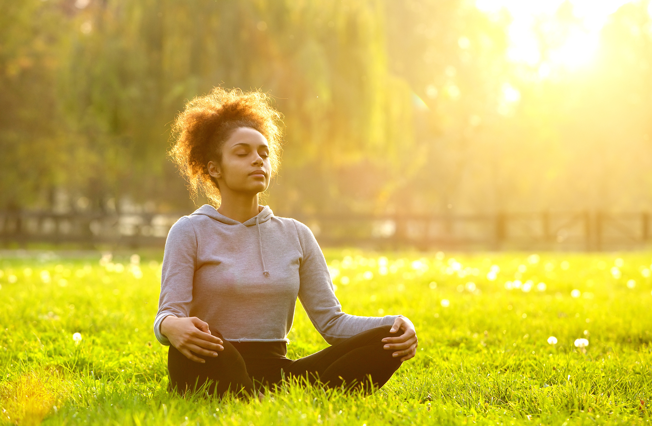 Generic photo of woman meditating outdoors (Thinkstock/PA)