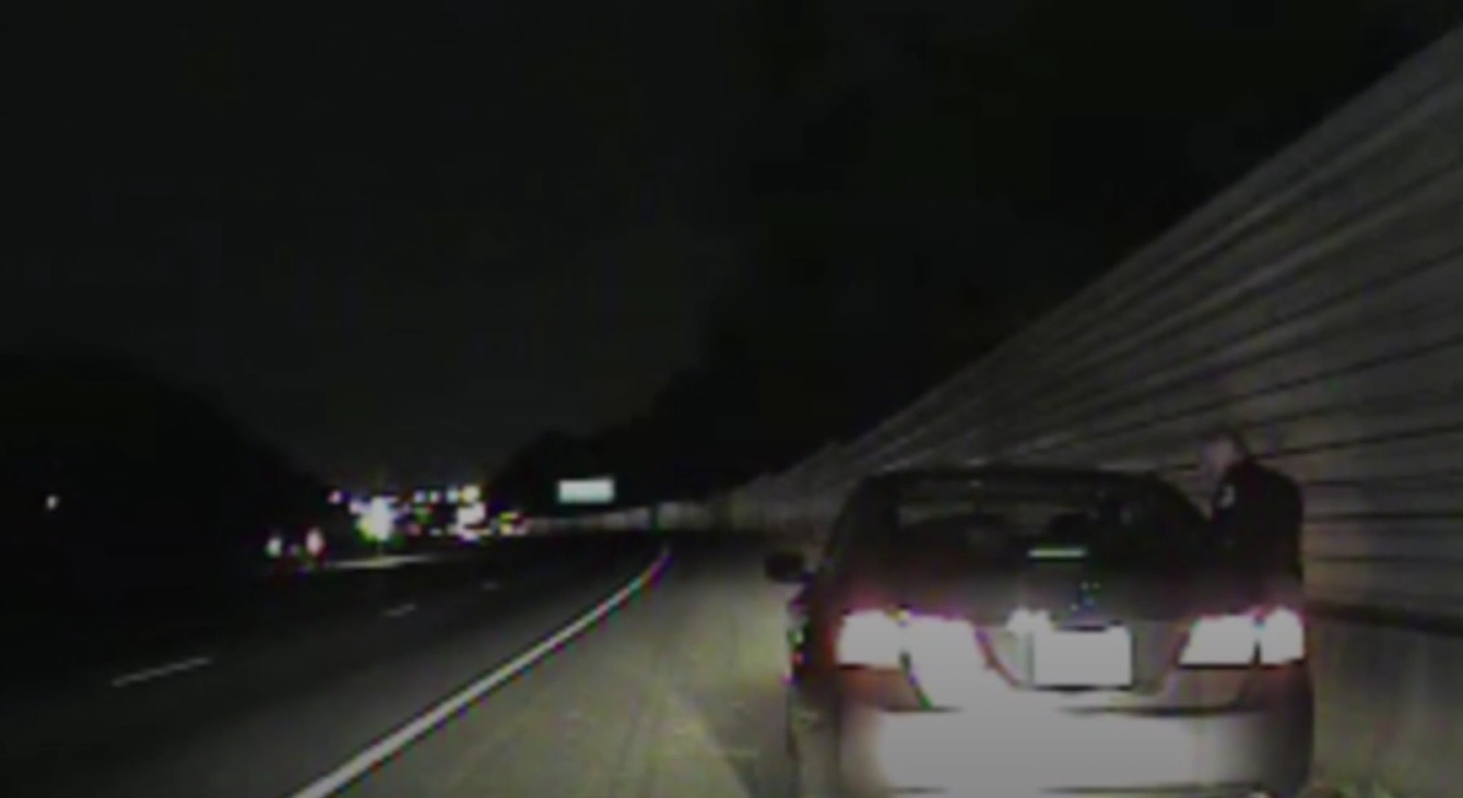 An image of Lieutenant Greg Abbott talking to a driver, taken from video from Cobb County Police Department