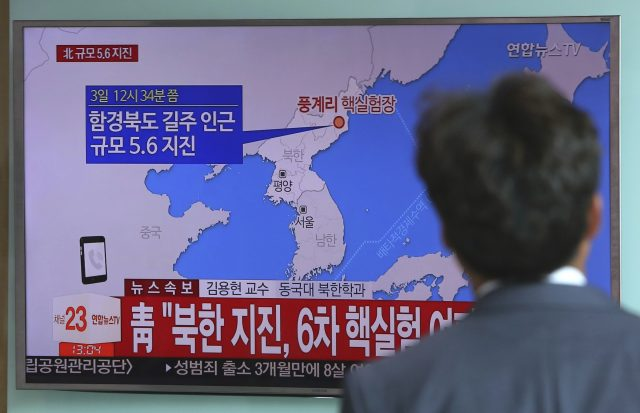 A man watches a TV news report about a possible nuclear test conducted by North Korea. (AP)