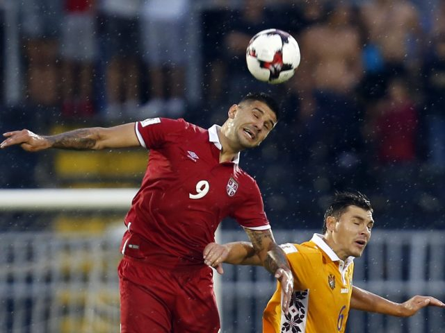 Serbia's Aleksandar Mitrovic, left, challenges Moldova's Alexandru Epureanu, during the World Cup Group D  match against Moldova