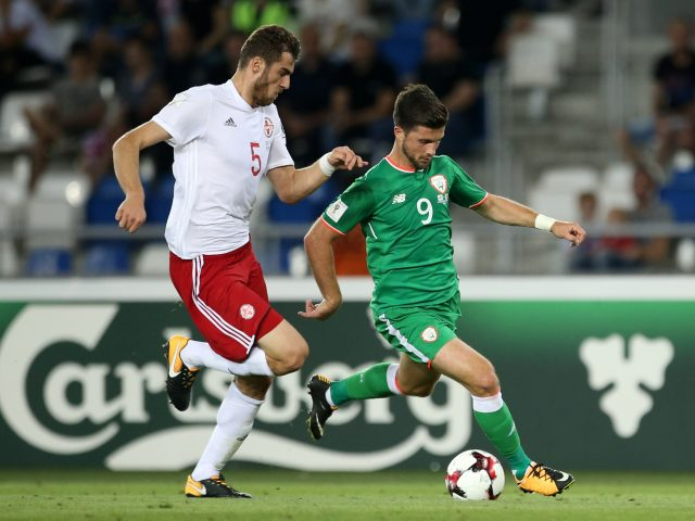 Georgia's Solomon Kverkvelia (left) and Republic of Ireland's Shane Long battle for the ball during the 2018 FIFA World Cup Qualifying match