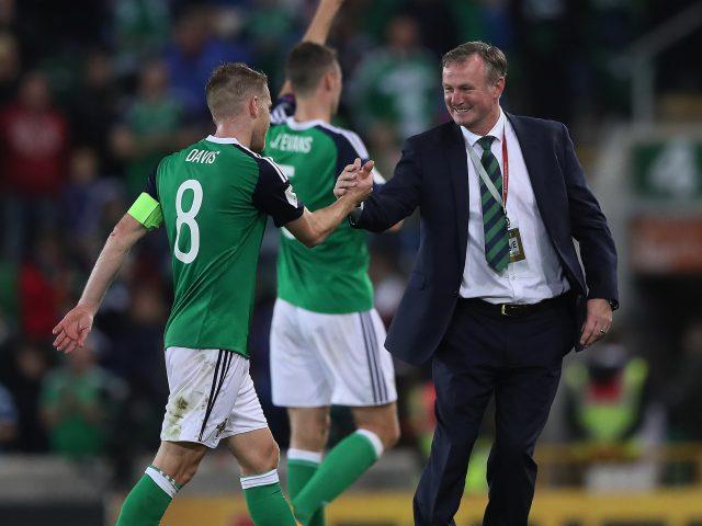 Northern Ireland manager Michael O'Neill celebrates with Steven Davis after the 2018 FIFA World Cup Qualifying match with Czech Republic
