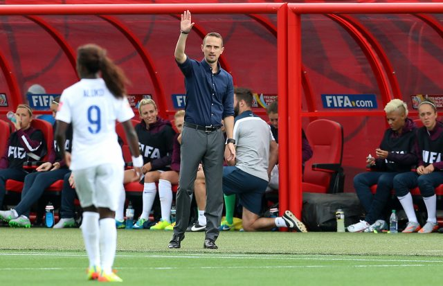 Mark Sampson, centre, and Eni Aluko, left, at the 2015 Women's World Cup  (Vaughn Ridley/Empics)