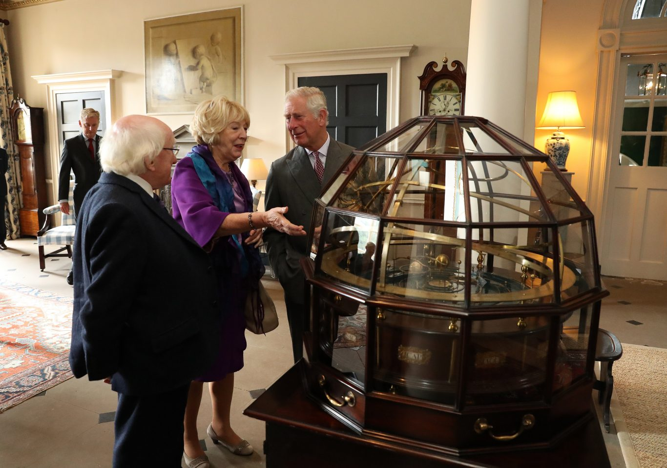 The Prince of Wales,  President of Ireland and his wife Sabina view the Grand Orrery, an 18th century mechanical model of the solar system (Andrew Milligan/PA)