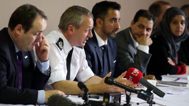 Deputy Chief Constable Iain Livingstone, in the white shirt, will take over leadership of Police Scotland until further notice