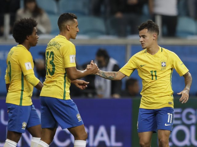 Brazil's Philippe Coutinho right celebrates with Brazil's Marquinhos center after scoring his side's second goal