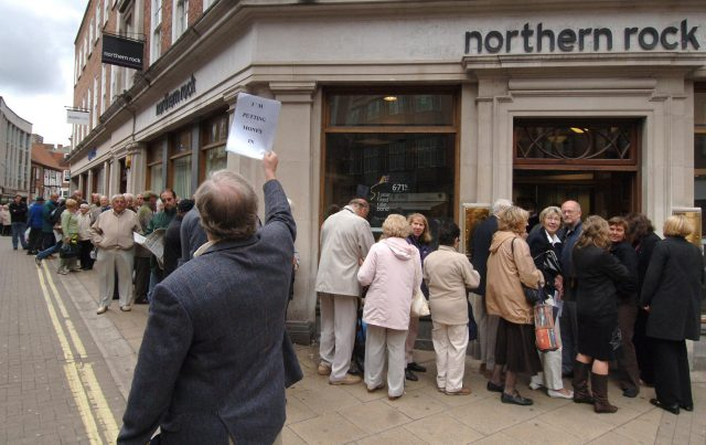 Customers queuing outside a Northern Rock branch in 2007 (PA)