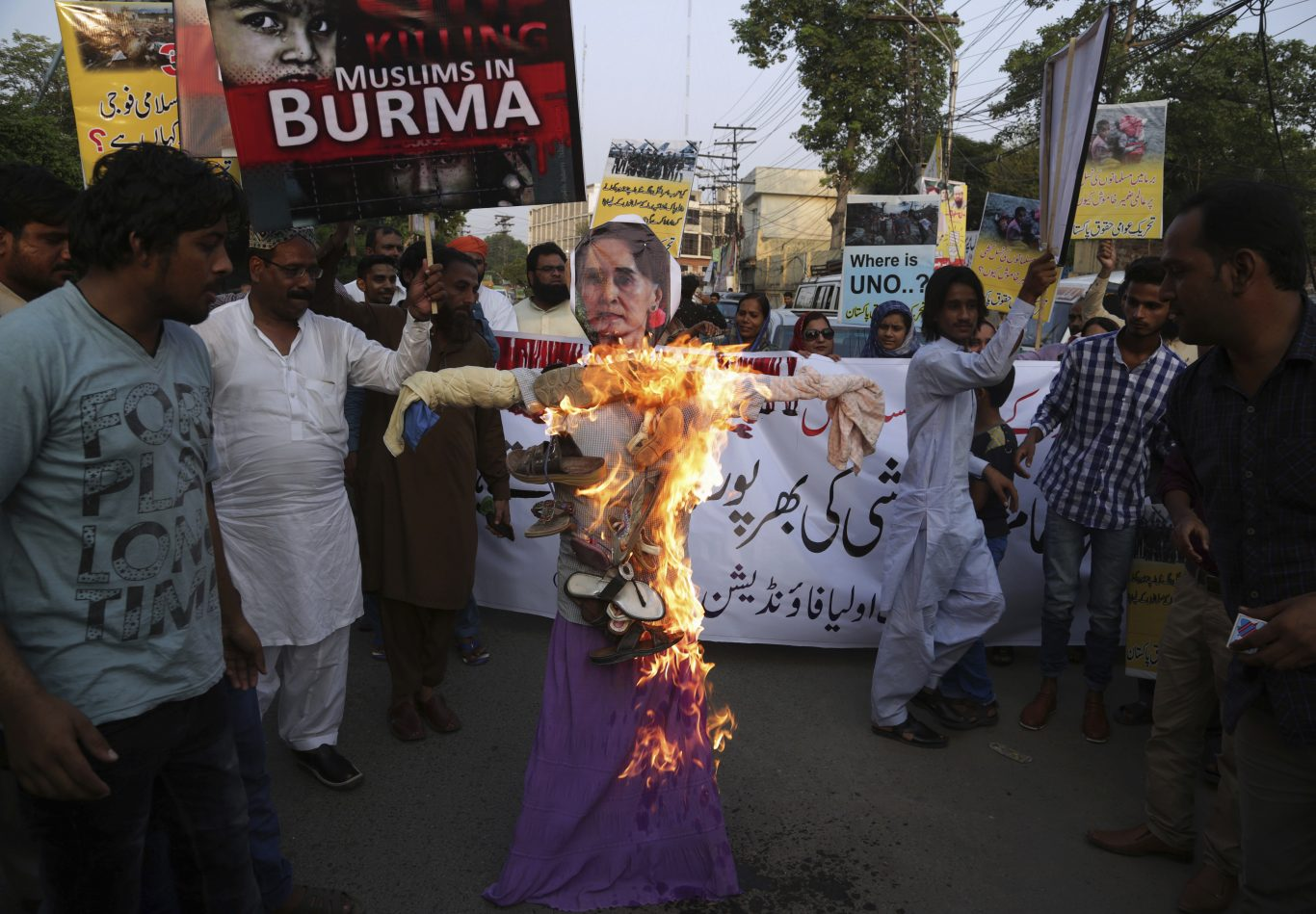 Pakistani protesters burn an effigy of Myanmar State Counsellor Aung San Suu Kyi (K.M. Chaudary/AP)