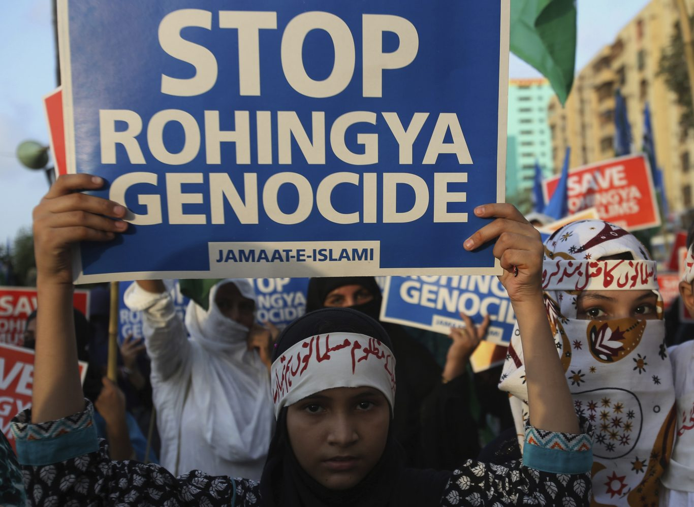 Young supporters of Jamaat-e-Islami, a Pakistani religious group, take part in a rally to condemn ongoing violence against the Rohingya Muslim minority in Myanmar, in Karachi, Pakistan (Fareed Khan/AP)